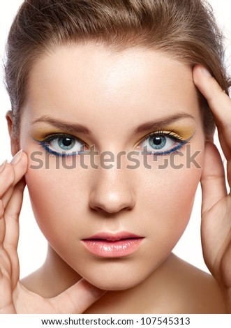 beautiful girl with a bright lemon-colored make-up - stock photo