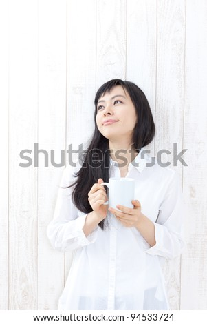 beautiful girl with a cup of coffee - stock photo
