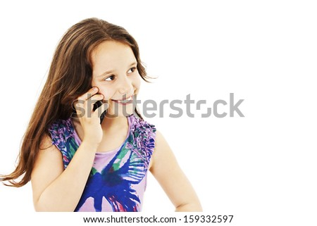 Beautiful girl with a happy expression talking on the phone. Isolated on white background  - stock photo