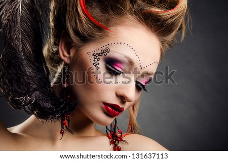 Beautiful girl with a mask and make up on gray background - stock photo