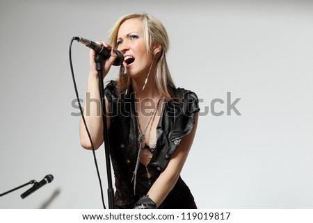 Beautiful girl with a microphone - stock photo