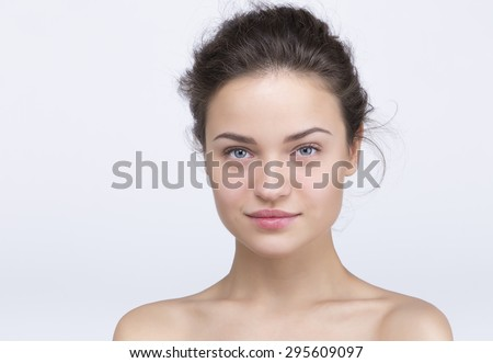 beautiful girl with a mysterious smile - stock photo