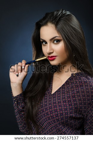 beautiful girl with a pen - stock photo