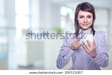 Beautiful girl with a phone in his hand. Communication with loved ones. Mobile telephony. Business negotiations - stock photo