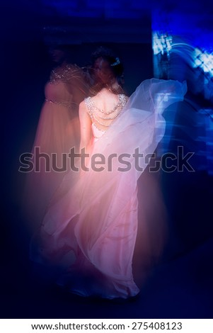 beautiful girl with a pink dress and flying hair - stock photo