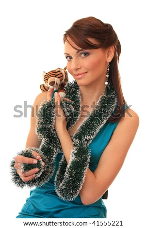 Beautiful girl with a toy tiger cub. On an east calendar New 2010 Year - year of tiger. - stock photo