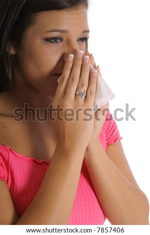 beautiful girl with allergies sneezing - stock photo