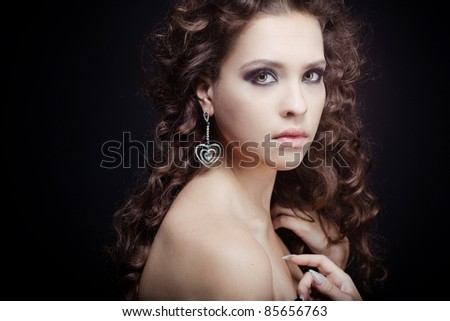 beautiful girl with an elegant evening make-up wearing jewelry - stock photo