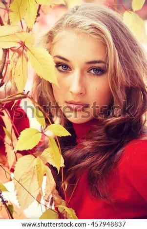 Beautiful girl with autumn makeup close up - stock photo