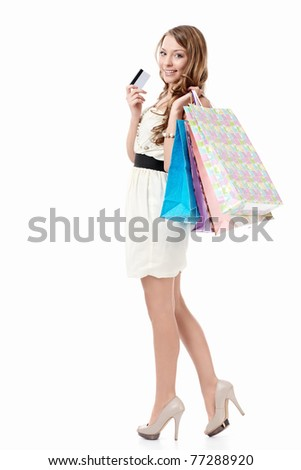 Beautiful girl with bags and credit card on a white background - stock photo