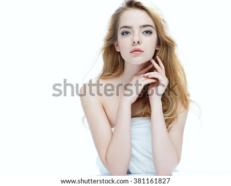 Beautiful girl with beautiful makeup, youth and skin care concept / photo of attractive blonde girl on white background - stock photo