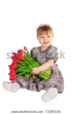 beautiful girl with bigh bouquet of tulips - stock photo