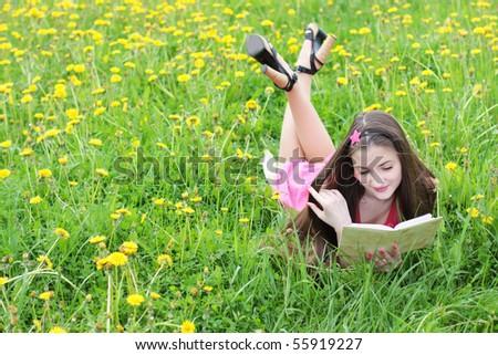 beautiful girl with book - stock photo