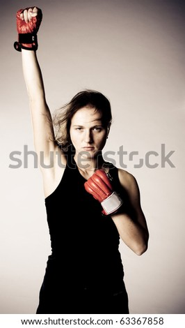 Beautiful girl with boxing gloves. - stock photo