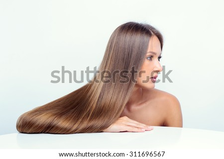 Beautiful girl with brown hair. fashion model. - stock photo
