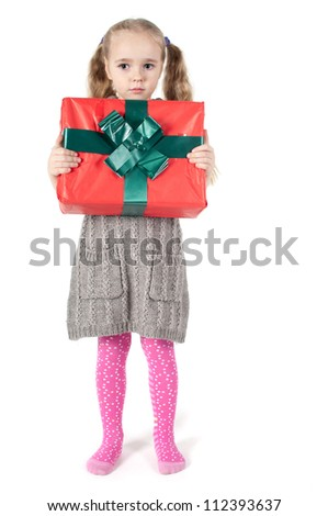 Beautiful girl with christmas present - stock photo