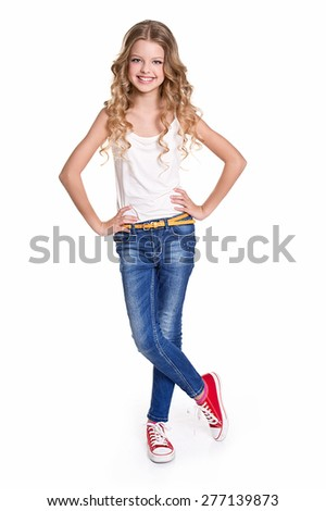 Beautiful girl with curly hair wearing jeans and a white t-shirt  - stock photo