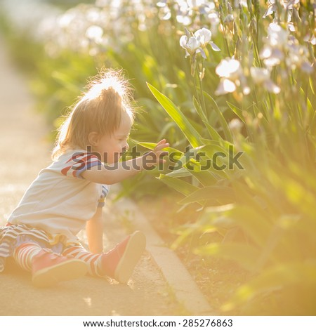 beautiful girl with Down syndrome walks at sunset - stock photo