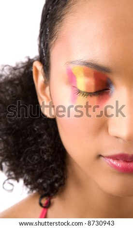 Beautiful girl with eyes closed and colorful makeup - stock photo
