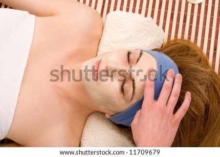 Beautiful girl with facial mask . - stock photo