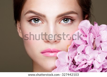 Beautiful Girl With  Flower .Beauty Model Woman Face. Perfect Skin. Professional Make-up.Makeup. Fashion Art - stock photo