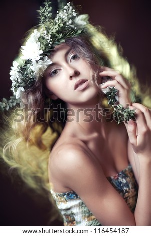 Beautiful girl with flowers in hair - stock photo