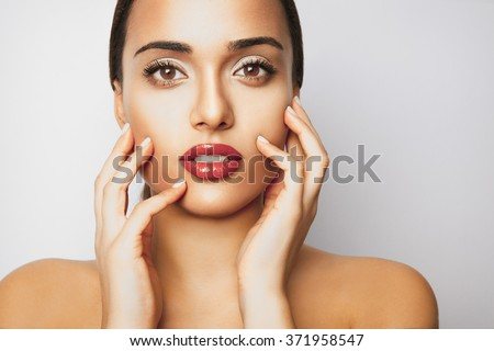 Beautiful girl with fresh skin and red lipstick. Beauty model woman face. Perfect skin. Professional Make-up and red lips .Makeup. Fashion art. Studio shot, horizontal  - stock photo