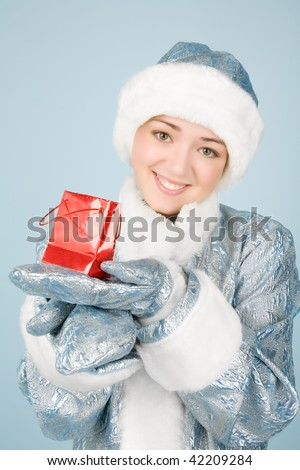 Beautiful girl with gift box  in new year costume - stock photo