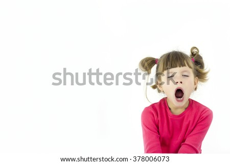beautiful girl with glasses sitting in school and yawns - stock photo