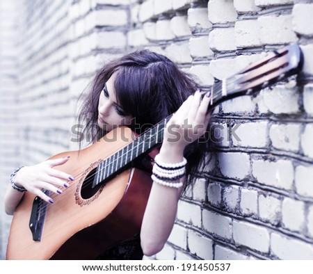 beautiful girl with guitar outdoor - stock photo
