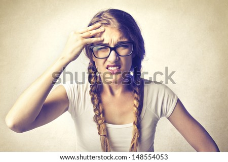 beautiful girl with headache - stock photo