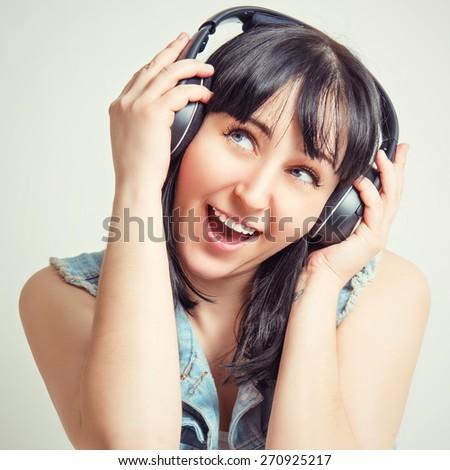 Beautiful girl with headphones listening to music. - stock photo