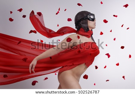 Beautiful girl with helmet and goggles and red veil - stock photo