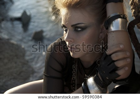 beautiful girl with intensive makeup in a rock style - stock photo