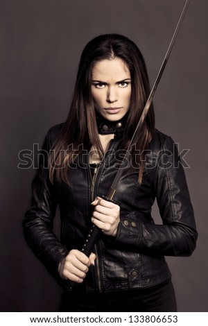 Beautiful girl with Katana in studio - stock photo