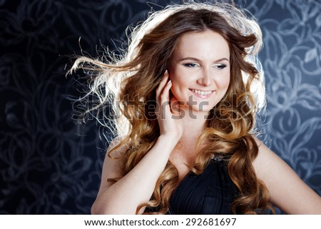 beautiful girl  with long brown curled hair,  happy laughter - stock photo