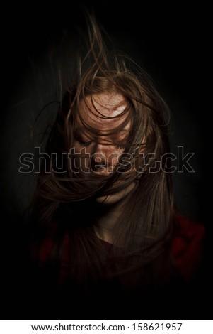 beautiful girl with long hair, developing - stock photo