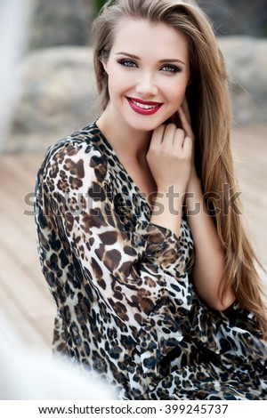 Beautiful girl with long hair. Smiling girl. Young pretty woman with beautiful long hairs and red lips - stock photo