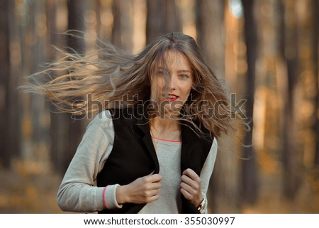 Beautiful Girl with long hair,wavy hair,thick hair,scattering hair,light hair,wavy hair,wound hair,brilliant hair,well-groomed hair,beautiful hair,shiny hair,long hair,healthy hair,clean hair,nicehair - stock photo