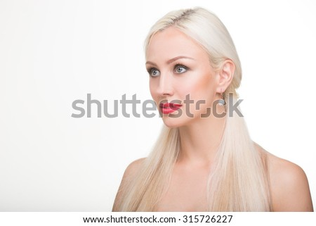 beautiful girl with long white hair and earrings. fashionable photo. portrait - stock photo