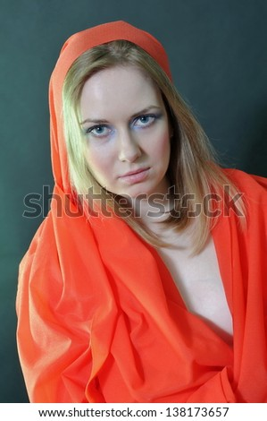 beautiful girl with makeup in a red cloth - stock photo