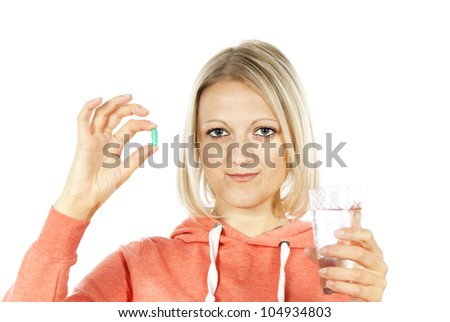 beautiful girl with medication and water - stock photo