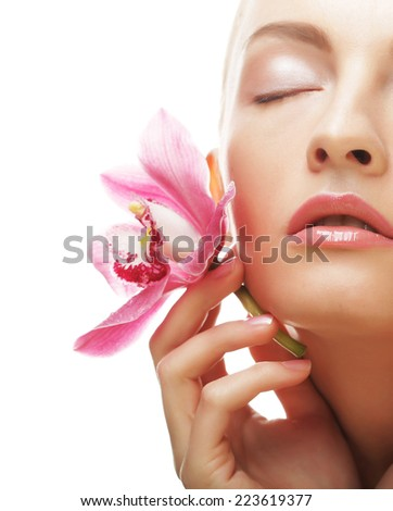 Beautiful girl with orchid flower.Beauty model woman face. - stock photo