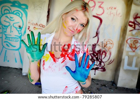 beautiful girl with painted hands among the ruined walls - stock photo