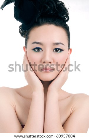 Beautiful girl with perfect makeup,hands touching the face - stock photo