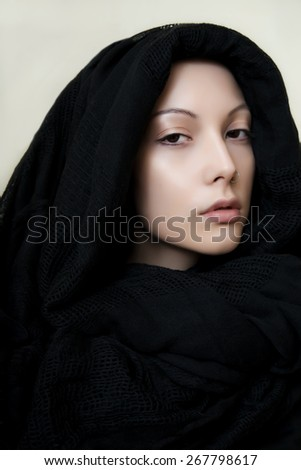Beautiful girl with perfect skin in a black scarf - stock photo
