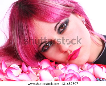 Beautiful girl with pink hair, red lipstick and brown eyes with a rose - stock photo