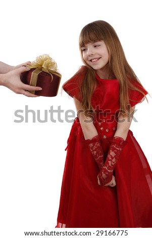 Beautiful girl with present.Little girl gets gift. Attractive lady holding purple box with gold ribbon.Attractive female is surprising at present.Isolated over white background. Schoolgirl feels shy. - stock photo