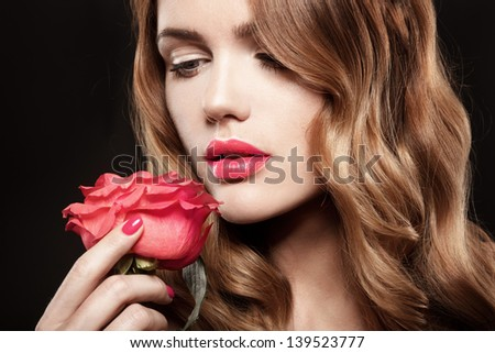 Beautiful Girl With rose.Beauty Model Woman Face.  Perfect Skin. Professional makeup. Fashion Art - stock photo