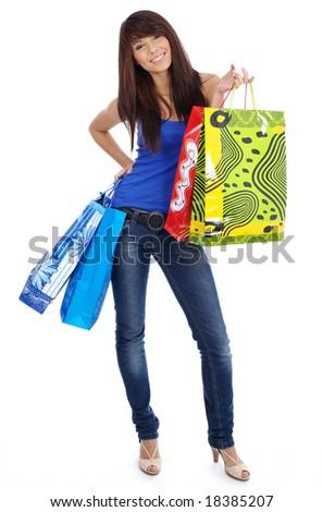 Beautiful girl with shopping bag - stock photo